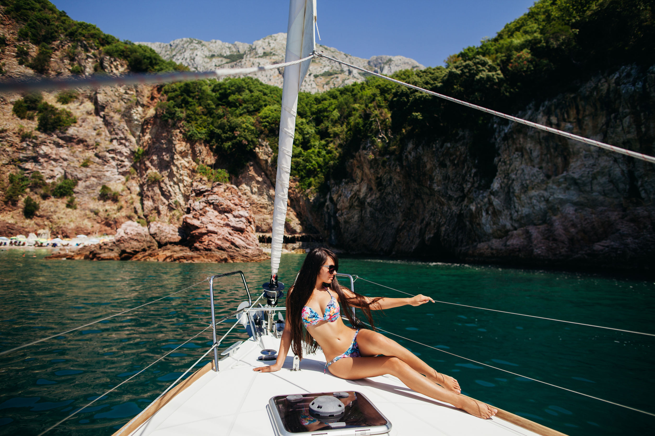 48781016 - sexy long hair girl in swimwear on yacht in montenegro